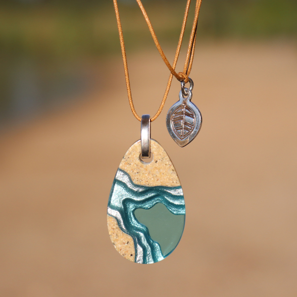 Cove pendant with coastal background