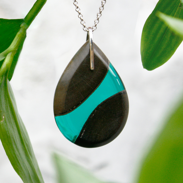 Tear drop greywood pendant in emerald green