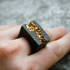 Anakie gold statement ring on hand stone background