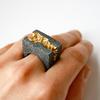 Anakie gold statement ring on hand white background