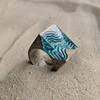 Rift light blue resin statement ring in beach sand