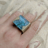 Rift light blue resin statement ring on hand