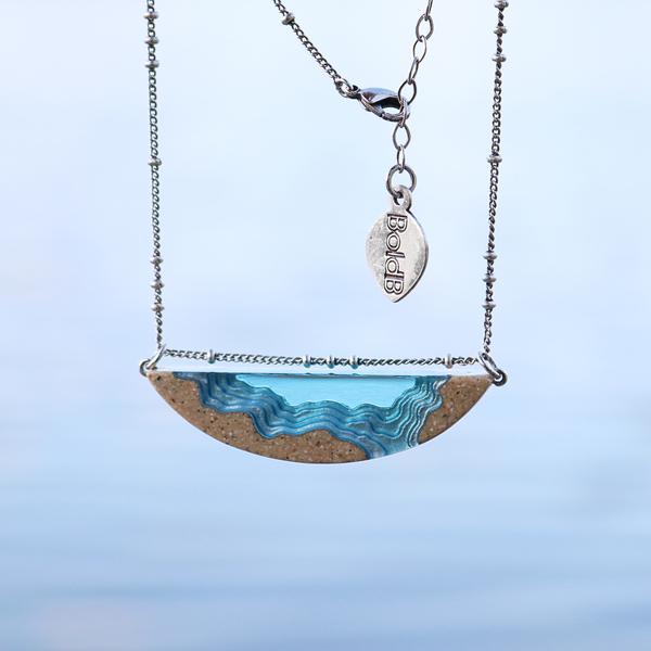 Longshore handmade beach sand and resin necklace on beach